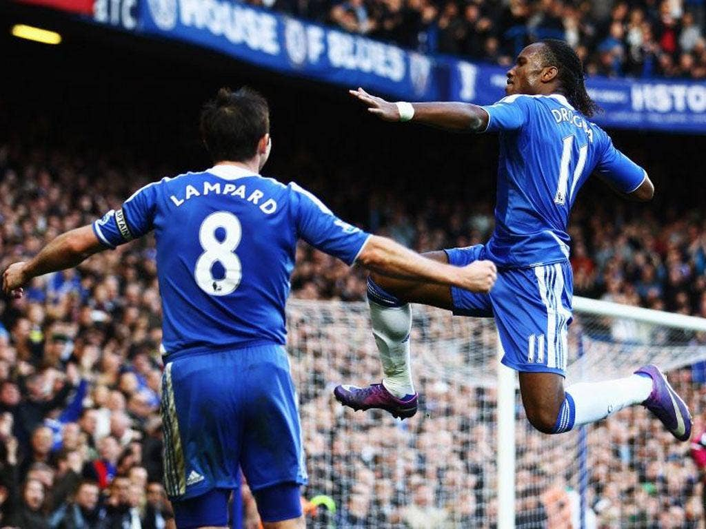 Didier Drogba celebrates with captain Frank Lampard