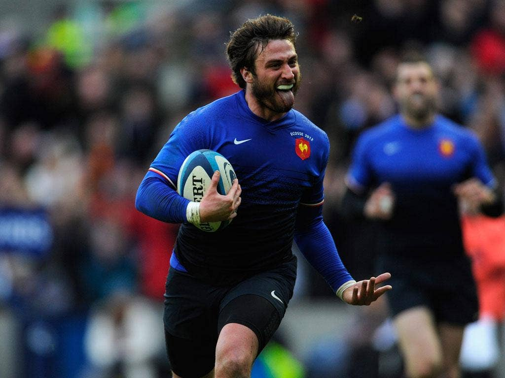 France fullback Maxime Medard runs in his try during the RBS Six Nations match between Scotland and France