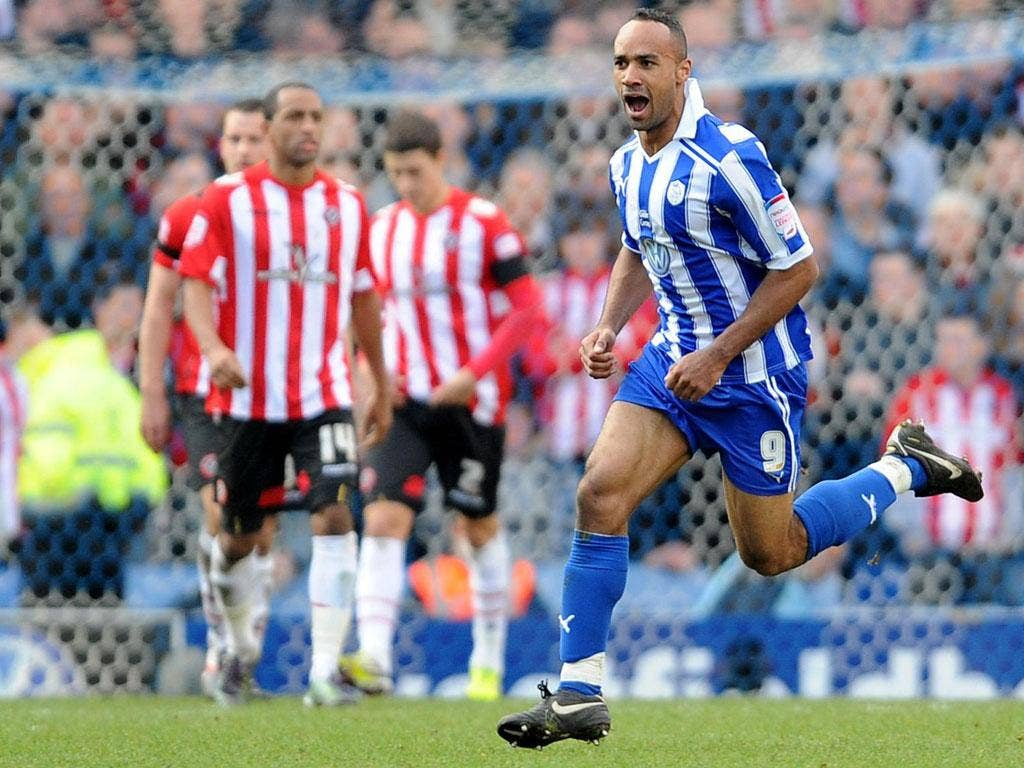 Chris O'Grady turns away after scoring Sheffield Wednesday's winner