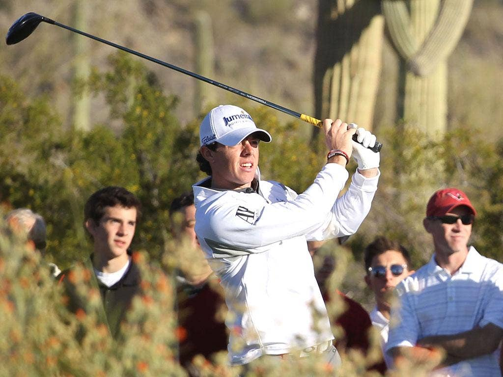 Rory McIlroy hits his tee shot on the seventh hole during the semifinal against Lee Westwood