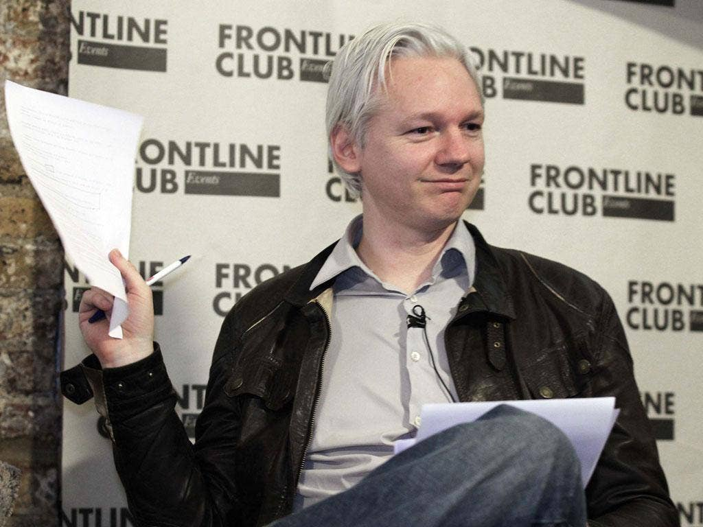 February 27, 2012: WikiLeaks founder Julian Assange holds a document containing leaked information at a news conference in London. The anti-secrecy group WikiLeaks began publishing on Monday more than five million emails from a U.S.-based global security