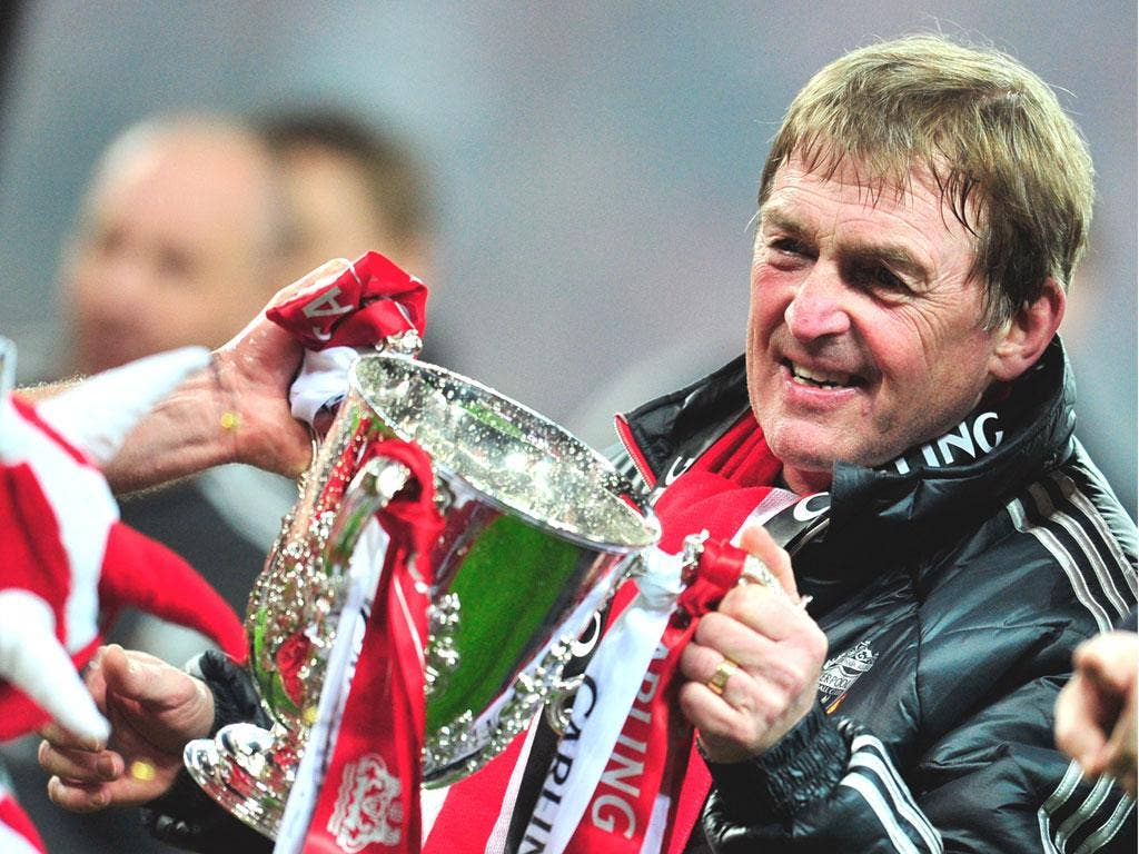 Kenny Dalglish grasps the Carling Cup, Liverpool's first trophy in six years