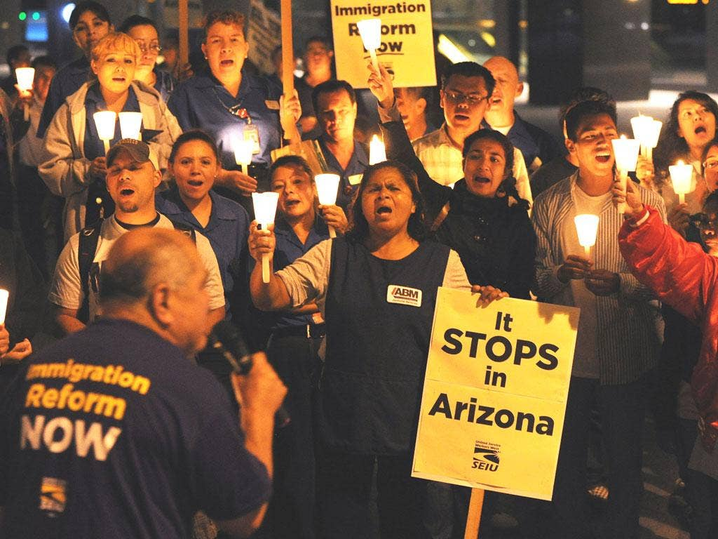 Mexican and Latino janitors hold a candlelight vigil calling for federal immigration reform