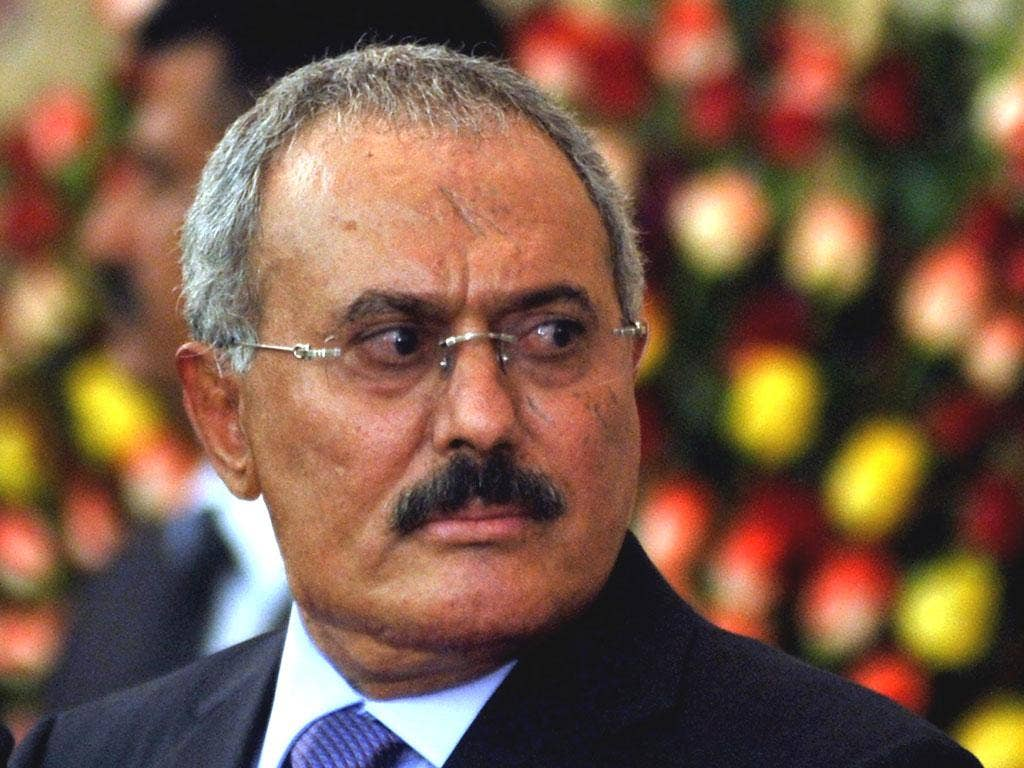 Former Yemeni president Ali Abdullah Saleh looks on after he formally handed power to newly elected president Abdo Rabbo Mansour Hadi