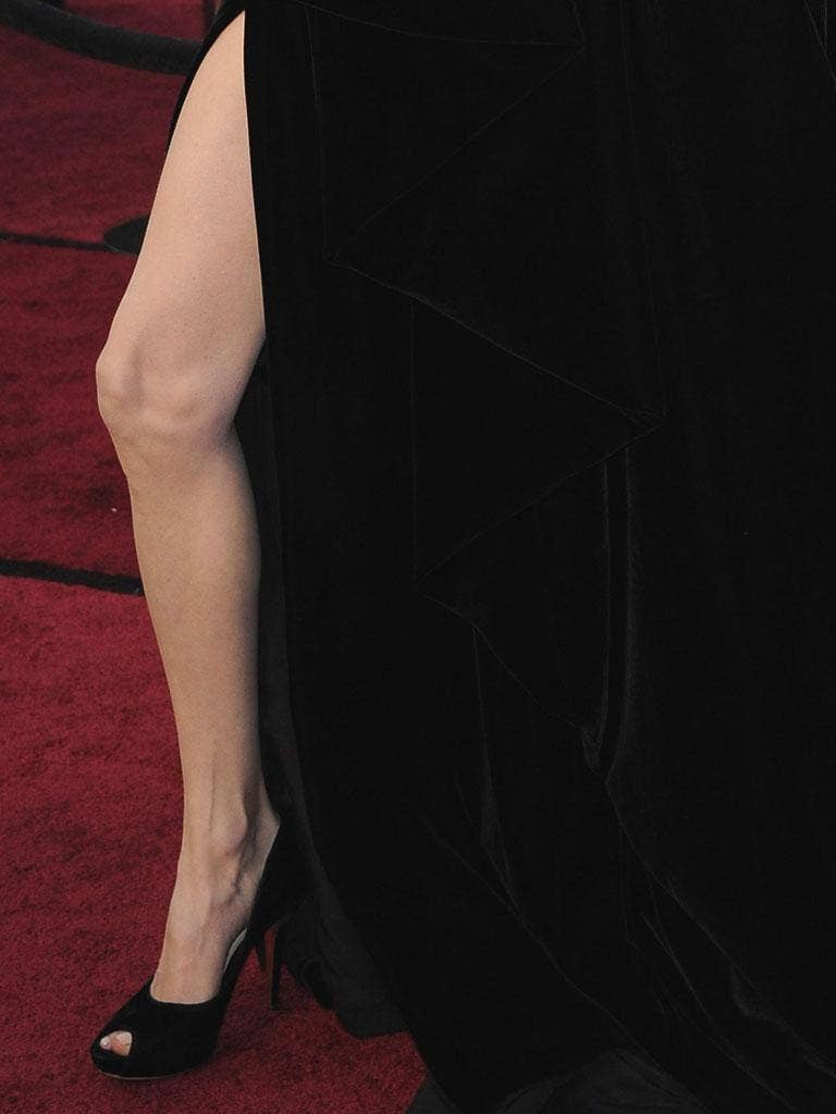 Angelina Jolie's waved her right leg through the high slit of her gown