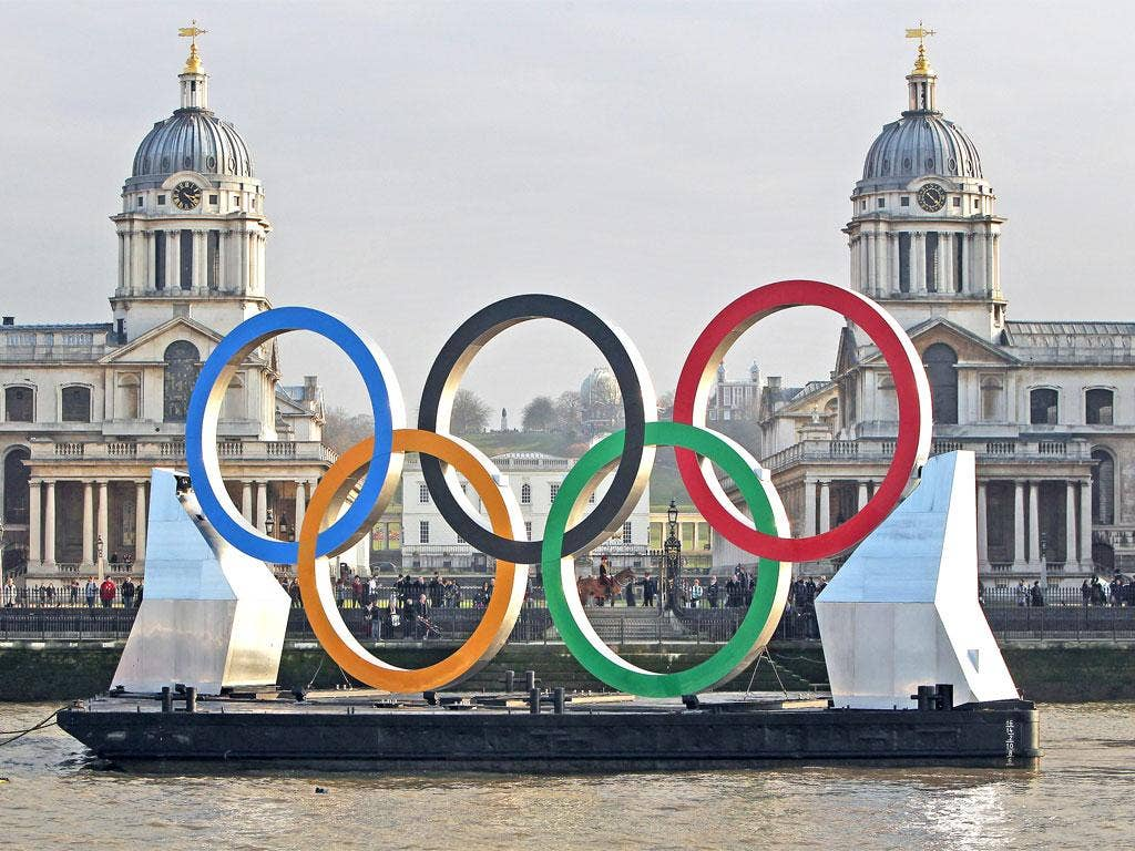 Olympic rings are towed on the Thames yesterday past the Royal Naval College at Greenwich, where equestrian events will be held in August