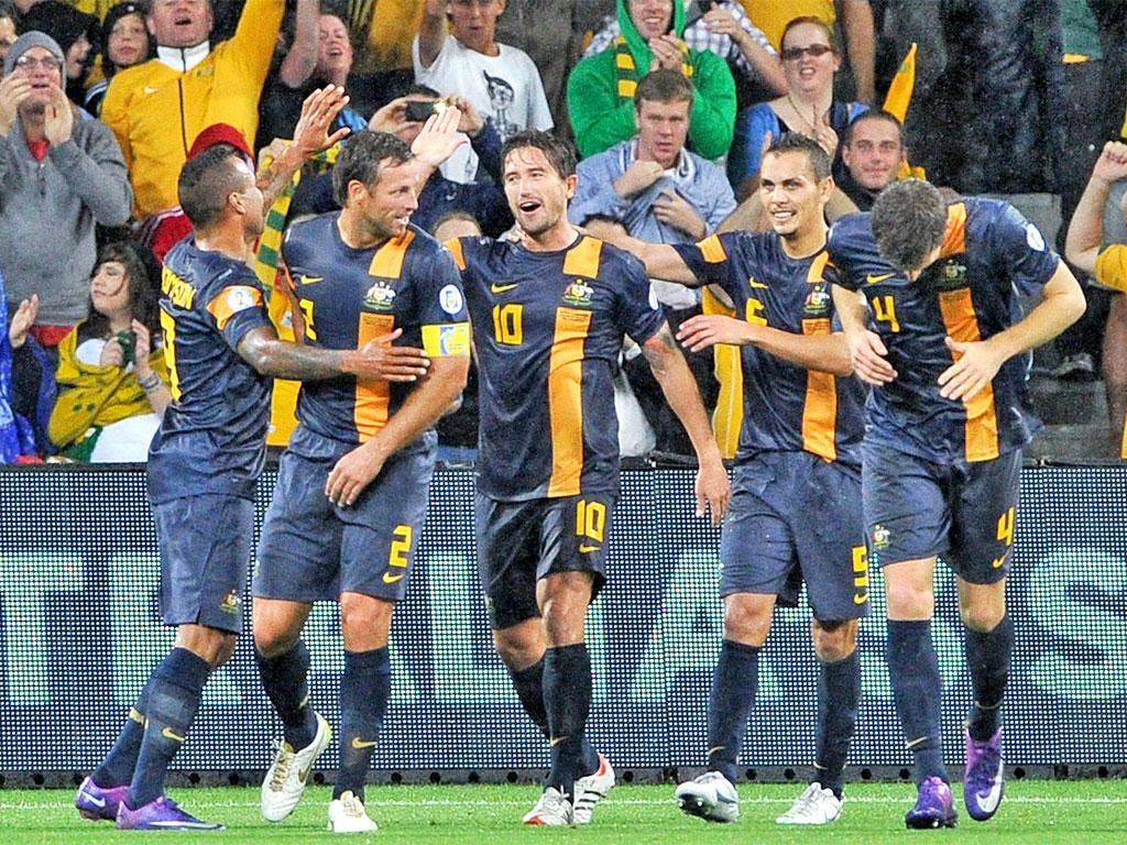 Harry Kewell is congratulated by team-mates after scoring Australia's second goal in Melbourne