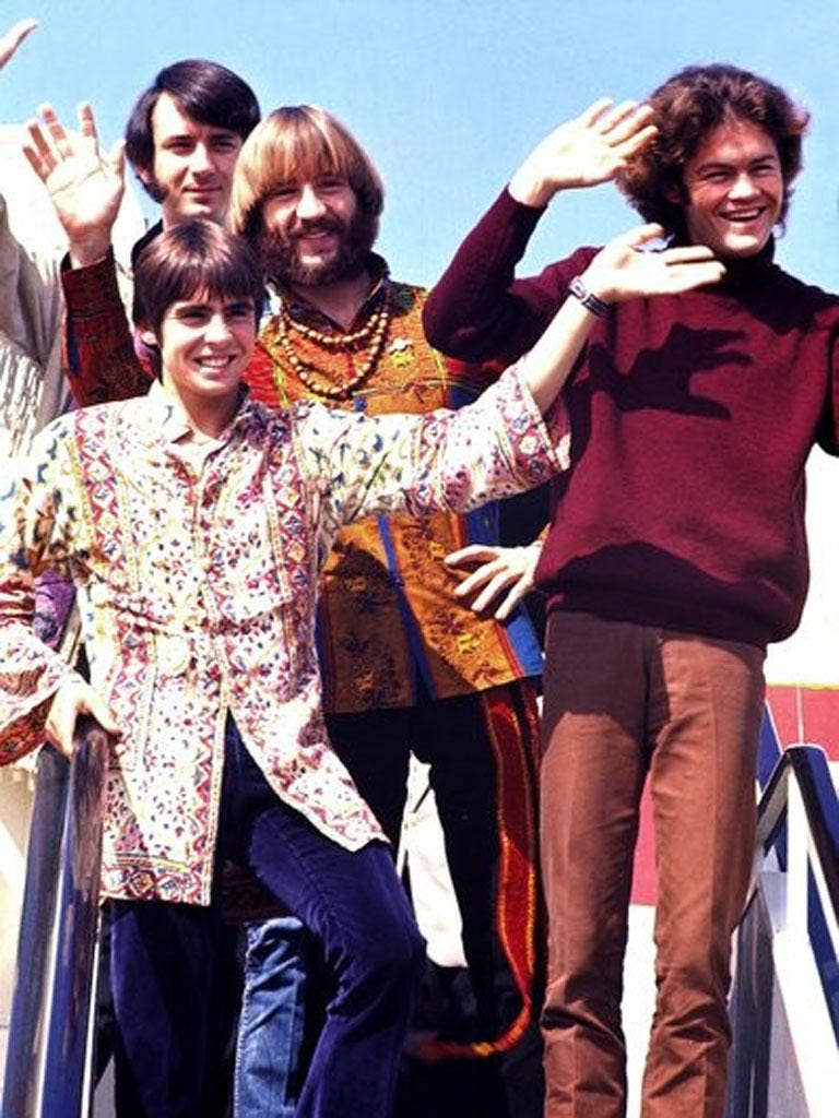 The Monkees land in Japan for a tour in 1968: from left, Jones, Mike Nesmith (behind Jones), Peter Tork and Mickey Dolenz