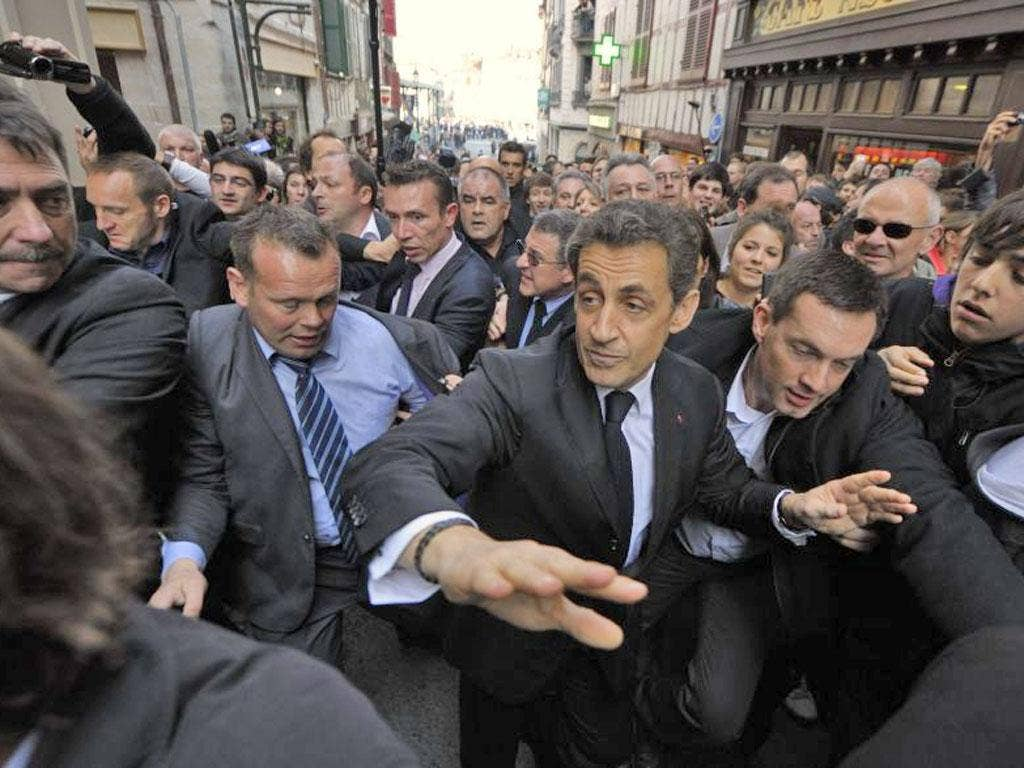 Riot police surrounded the Bar du Palais in Bayonne, where Mr Sarkozy holed up to get away from the protesters