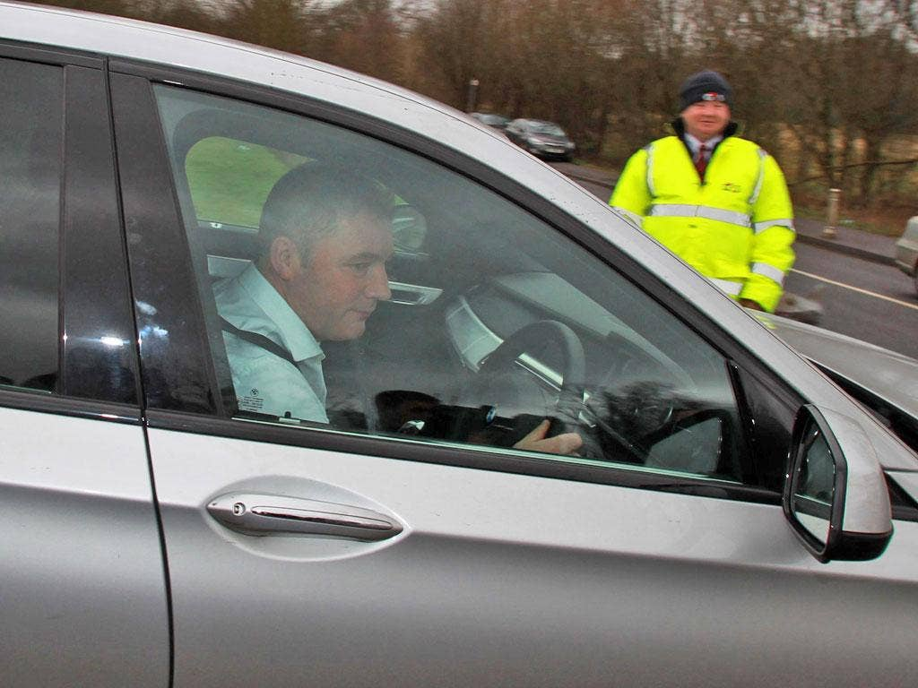 Rangers manager Ally McCoist leaves Murray Park in Glasgow yesterday