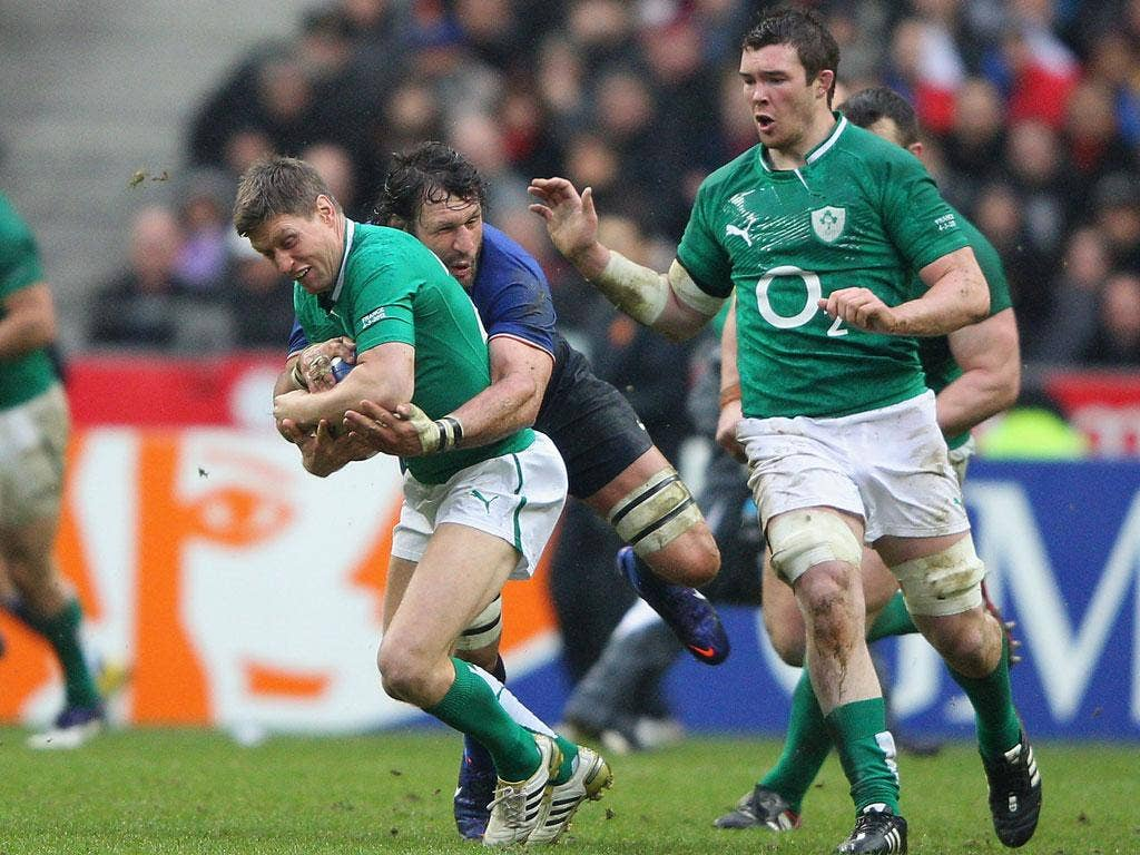 Ronan O'Gara of Ireland is tackled by Lionel Nallet