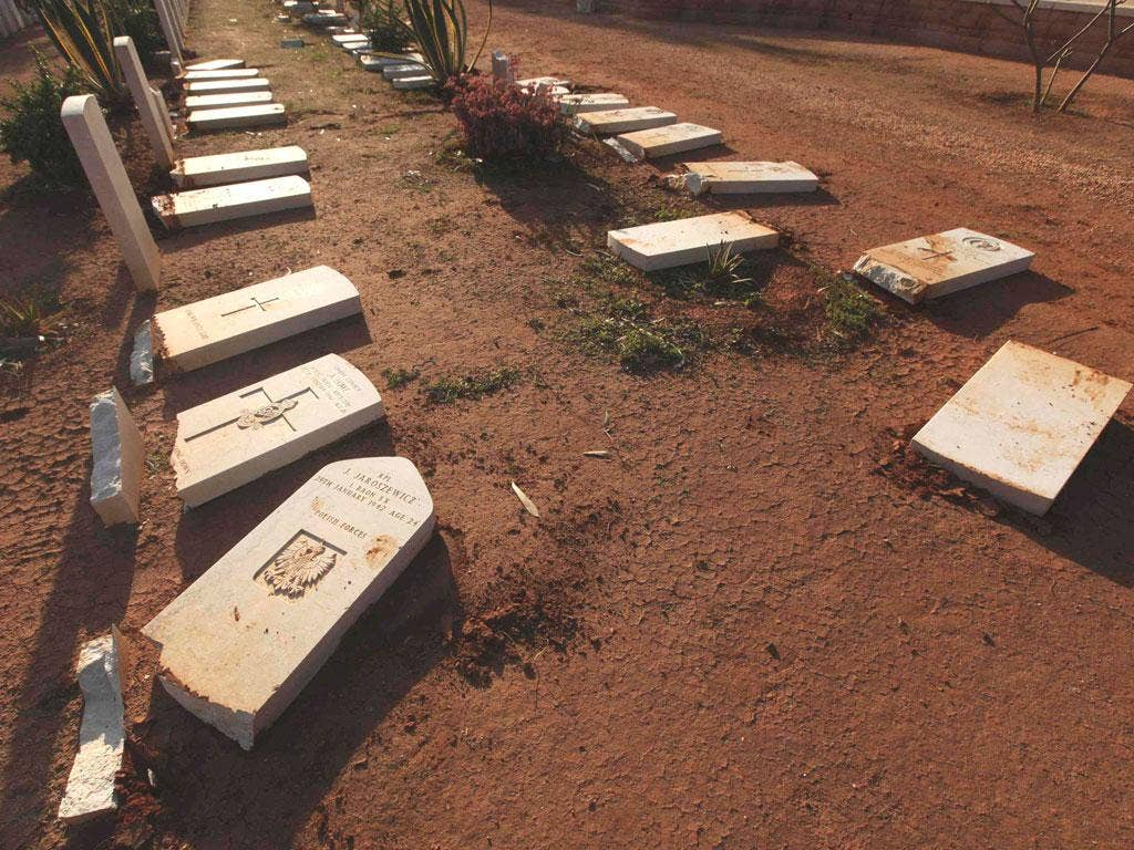 The vandalised graves at Benghazi Military Cemetery