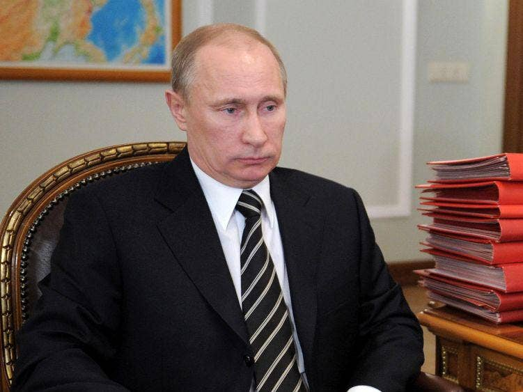 Vladimir Putin sits in his study in the Novo-Ogaryovo residence outside Moscow today