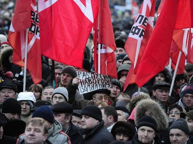 Opposition activists rally demanding fair elections at the Pushkinskaya Square in central  Moscow