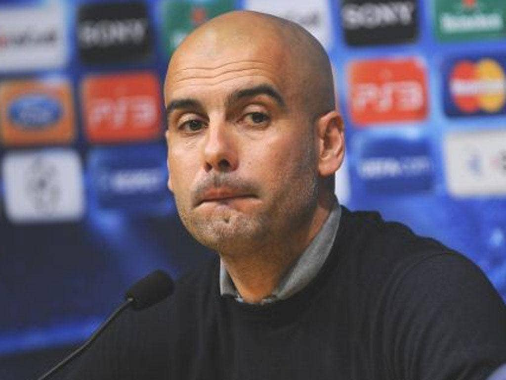 PEP GUARDIOLA: The Barcelona manager warned the 'job is not yet done' against Leverkusen