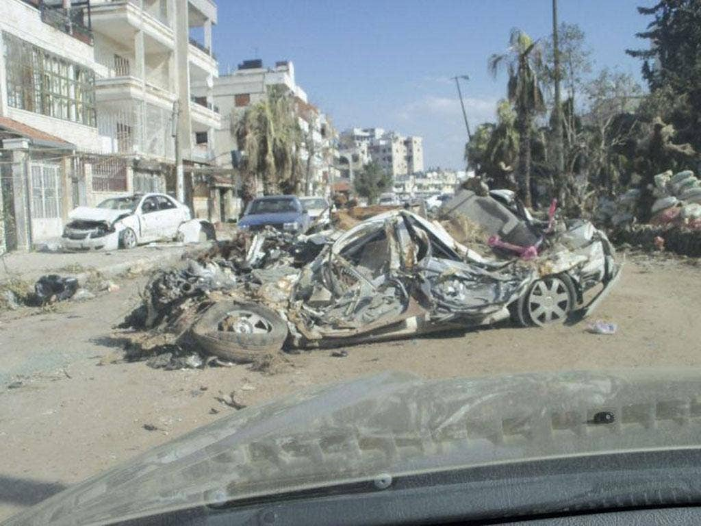 Destroyed cars in Homs