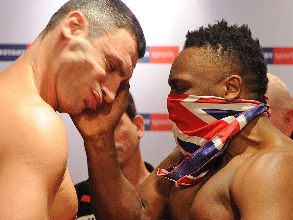 Chisora slaps Vitali Klitschko at the weigh-in in Munich