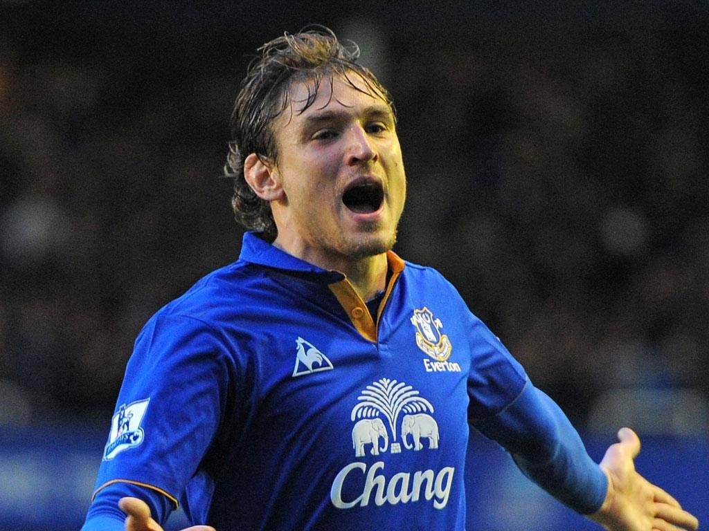 Everton's Croatian striker Nikica Jelavic celebrates scoring the opening goal of the match between Everton and Tottenham Hotspur