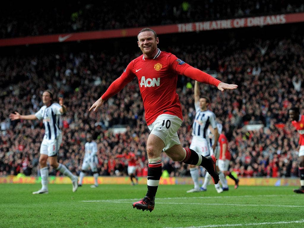 Rooney celebrates scoring the opening goal against West Bromwich Albion