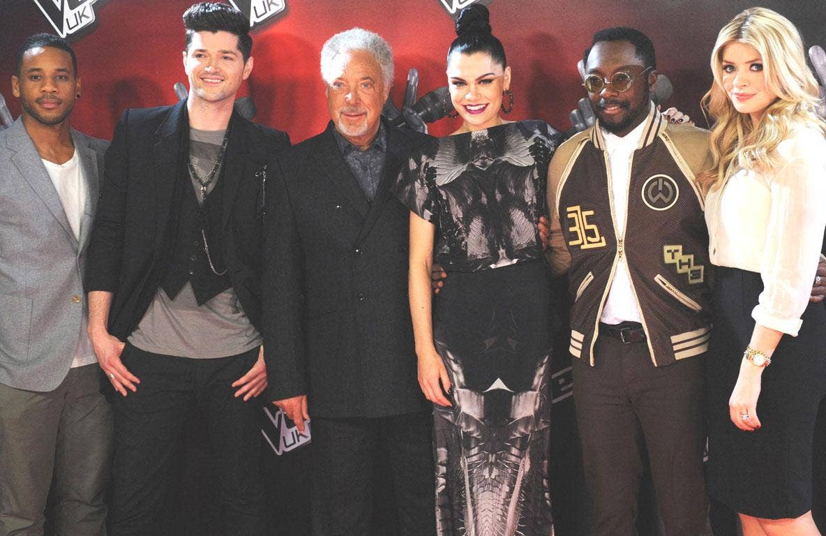 The cast of The Voice (l-r): Reggie Yates, Danny O'Donoghue, Tom Jones, Jessie J , Will.i.am and Holly Willoughby will go head-to-head with Simon Cowell's Britain's Got Talent on ITV