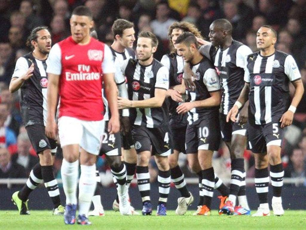 Hatem Ben Arfa celebrates with team-mates after scoring the opening goal during the Barclays Premier League match between Arsenal and Newcastle