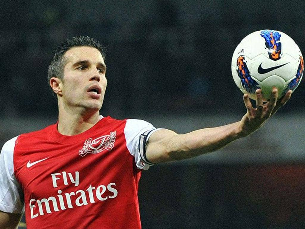 Robin van Persie, who scored Arsenal's first goal, gets hold of the ball