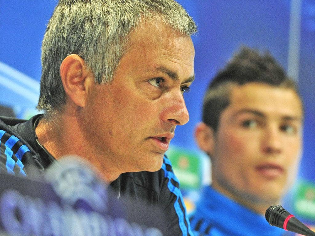 Jose Mourinho and Cristiano Ronaldo attend a press conference in Madrid yesterday