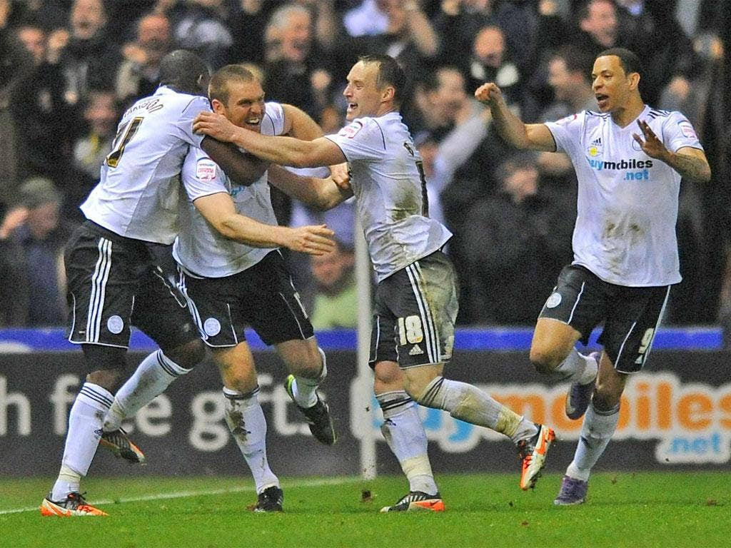 Derby's Jake Buxton (second left) celebrates his late winner last night