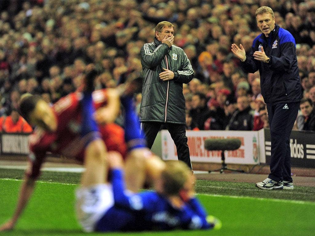 Kenny Dalglish (left) and David Moyes watch the action last night