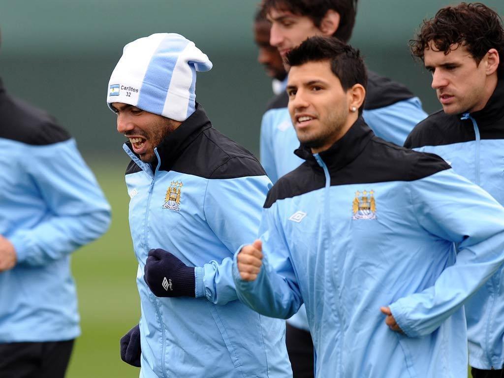 Carlos Tevez pictured training alongside Sergio Aguero this morning