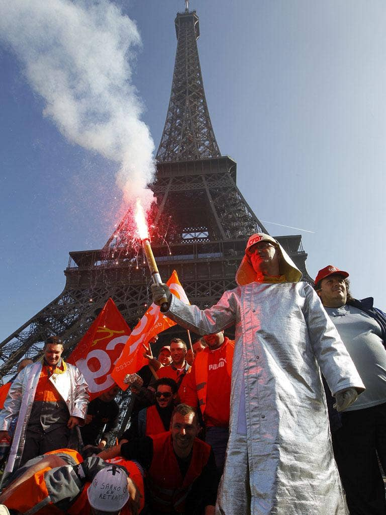 Riot police fired tear gas to disperse dozens of protesting steelworkers in Paris yesterday