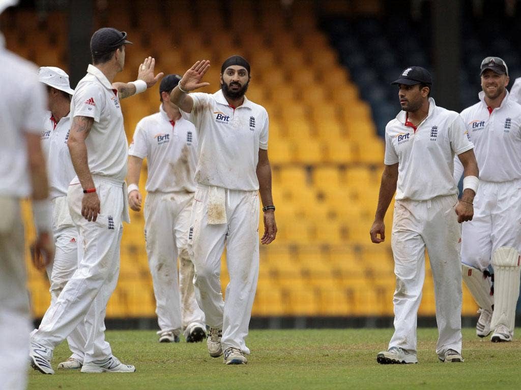 Monty Panesar (centre) celebrates one of his five wickets in Colombo