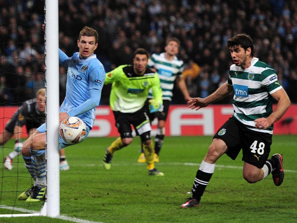 Citygoalkeeper Joe Hart (second right) looks on as his 95th-minute header grazes the Sporting post