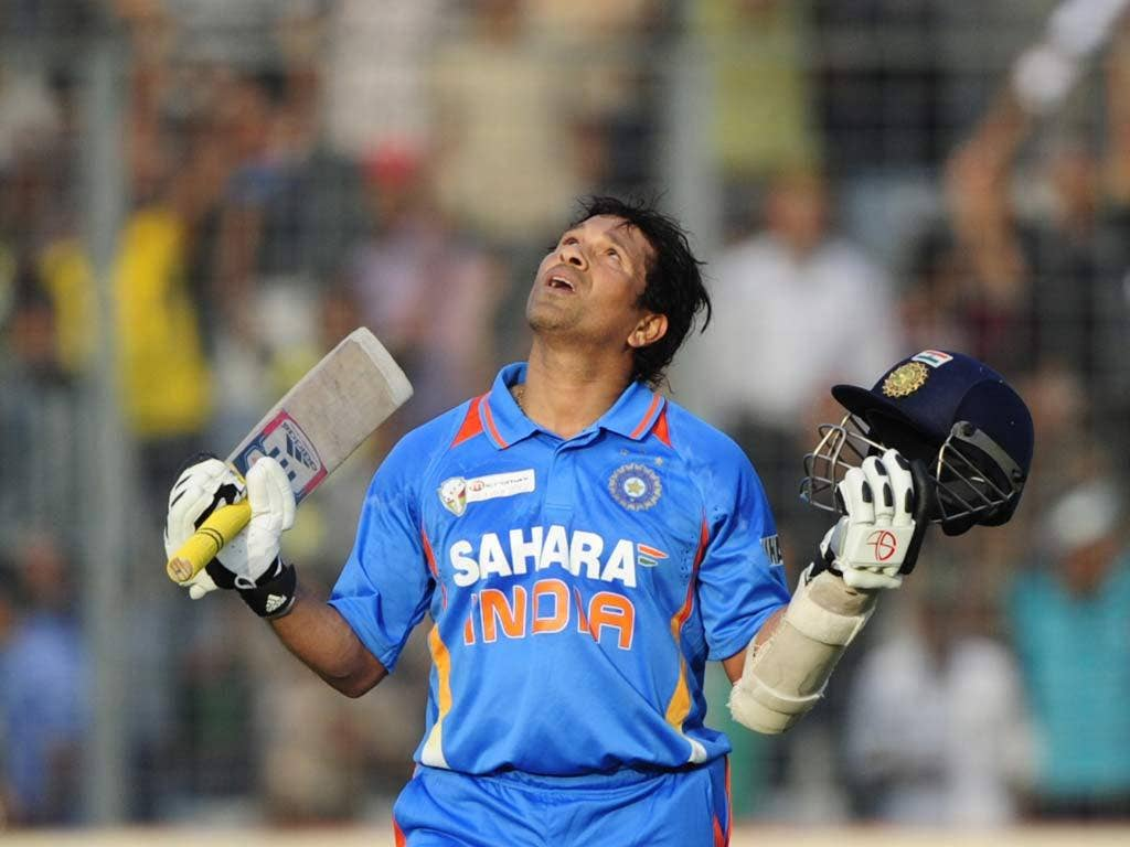 Sachin Tendulkar marks the moment he reaches his 100th Test century