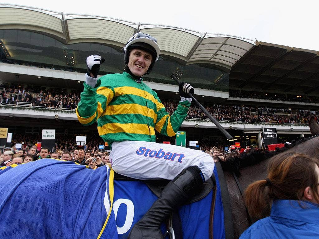 Tony McCoy celebrates ridding Synchronised to victory in the Betfred Cheltenham Gold Cup Steeple Chase