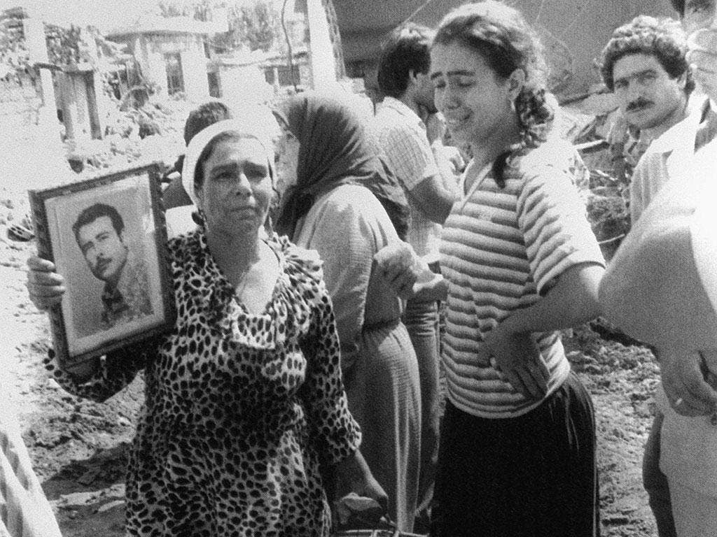 A Palestinian woman and her daughter mourn the death of her husband after the Sabra massacre in 1982