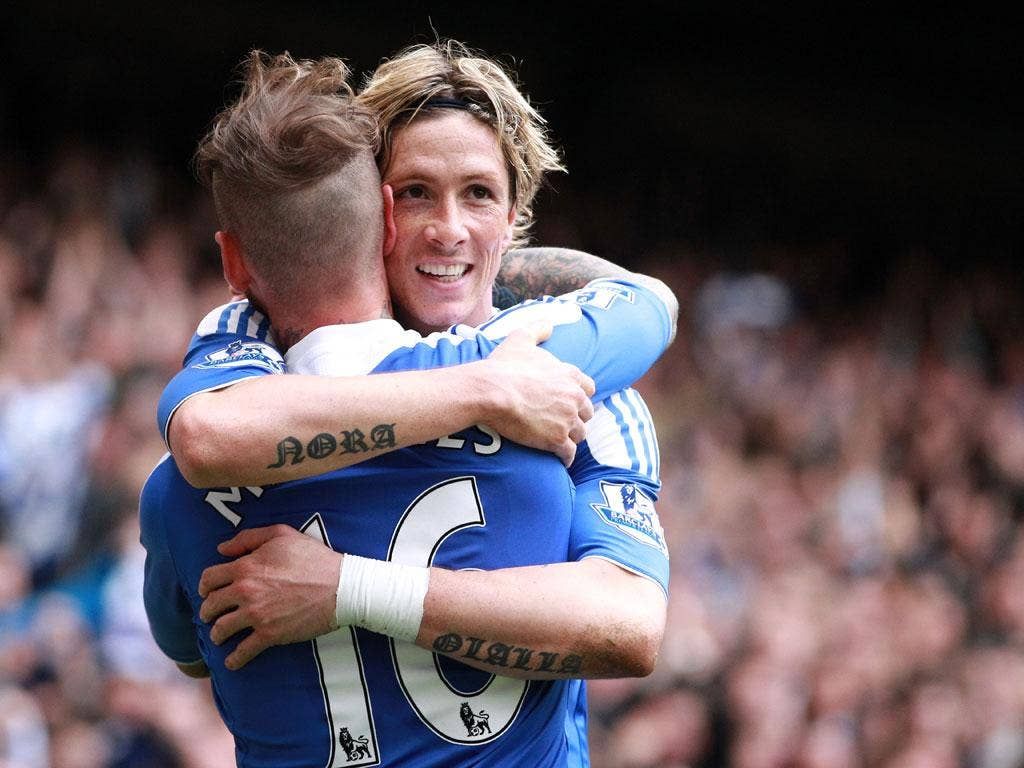 Torres is congratulated by Raul Meireles after his second goal at Stamford Bridge today