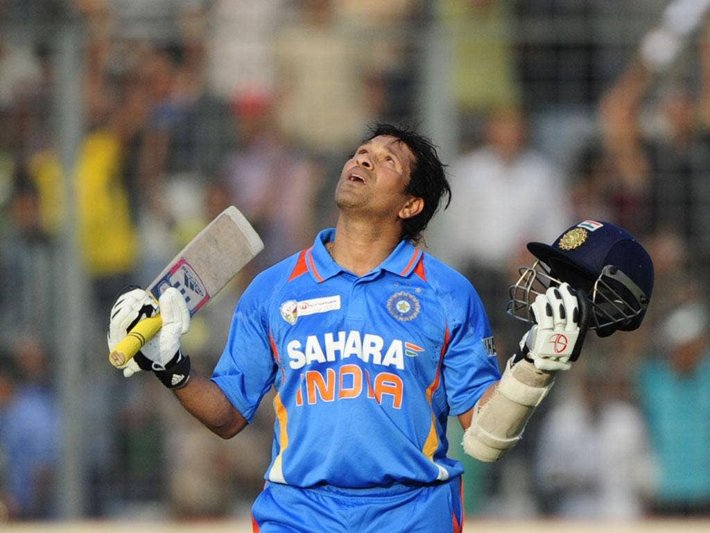 <b>16 March 2012</b><br/> Sachin Tendulkar celebrates scoring his historic 100th international century in India's one-day defeat to Bangladesh. The prolific Indian batsman, who had been waiting to achieve the milestone since March 2011, brought up the lan
