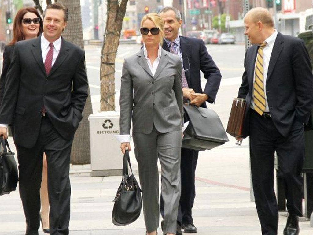 Actress Nicollette Sheridan arrives at the court with her legal team