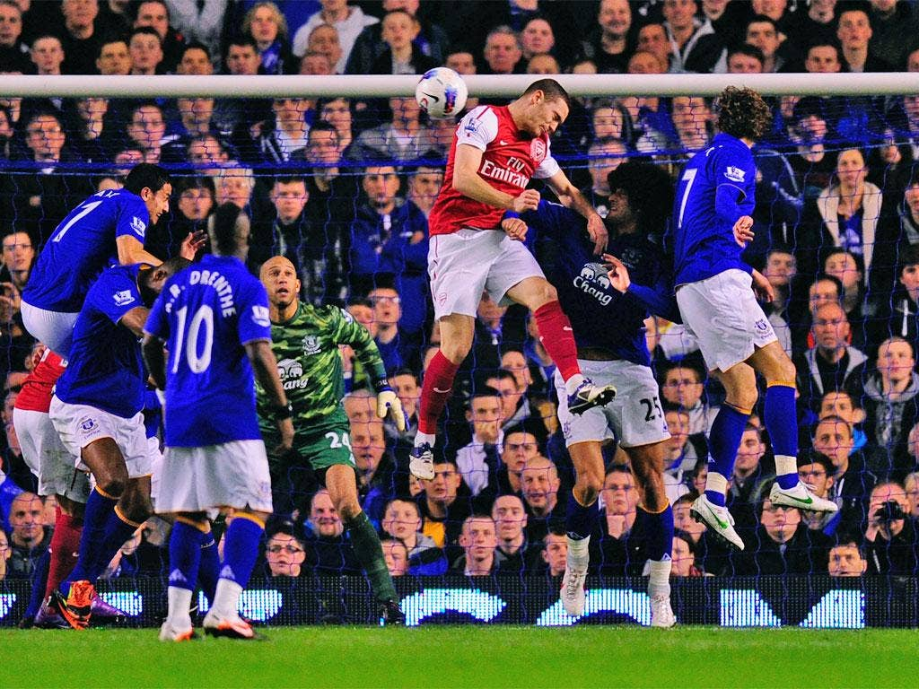 Thomas Vermaelen rises above the Everton defence to head Arsenal into the lead
