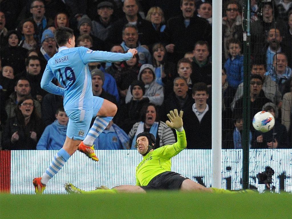 Samir Nasri slots in Manchester City's winner