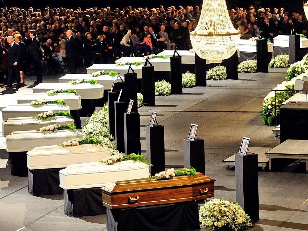 Coffins of the victims at the Soeverein Arena during the memorial service in Lommel