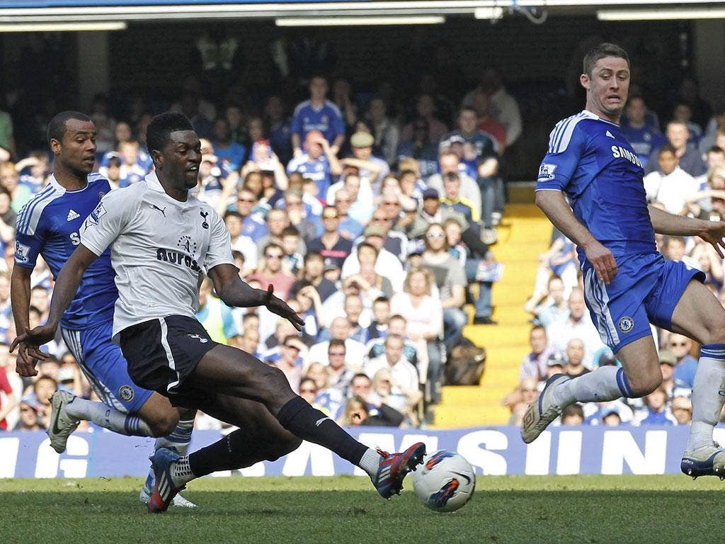 Gary Cahill defends a shot from Tottenham striker Emmanuel Adebayor