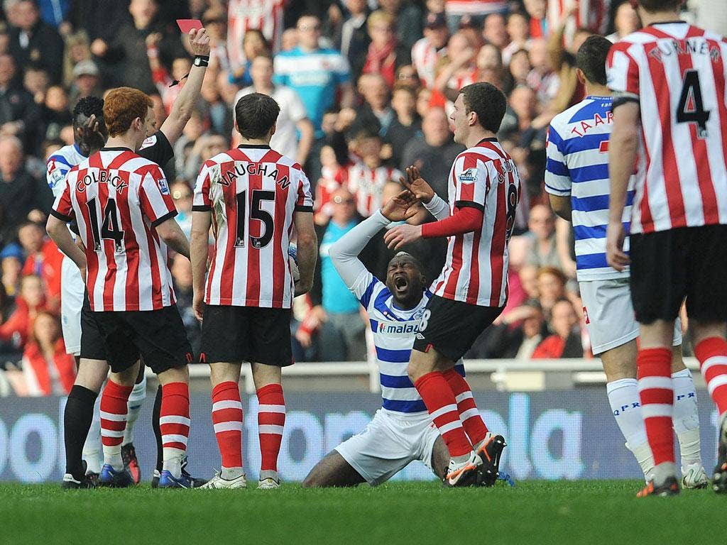 Red again: Djibril Cissé reacts to his sending-off at Sunderland, his second Rangers dismissal in the last five matches
