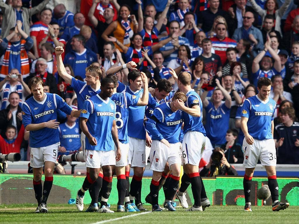 Lee Wallace of Rangers celebrates with team-mates after scoring his team's third goal