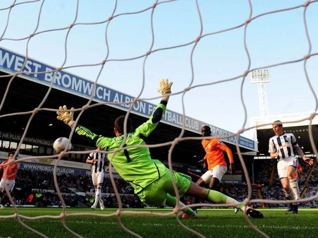 Newcastle's Papiss Cissé scores the opener at The Hawthorns