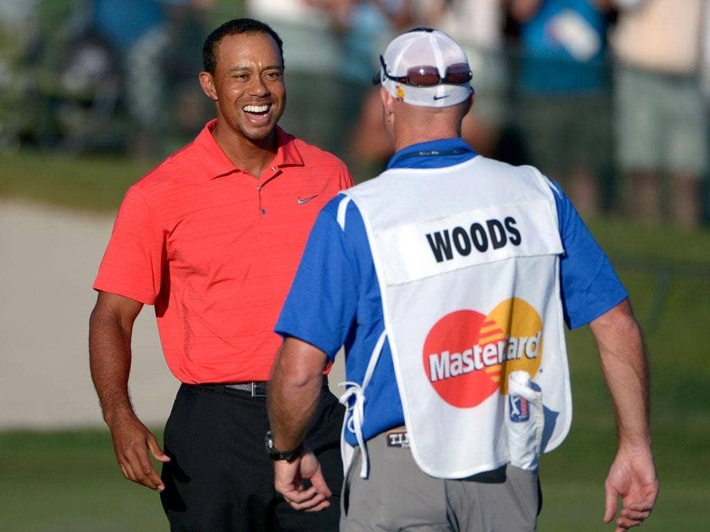 Tiger Woods celebrates with caddie Joe La Cava