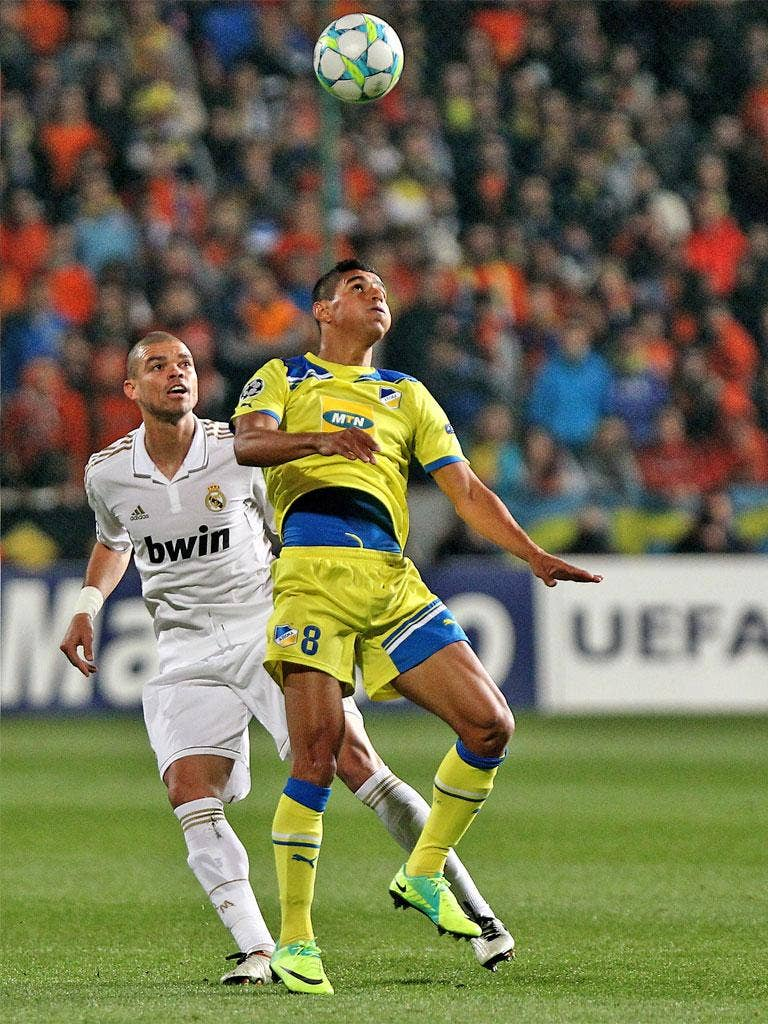 Apoel's Ailton (right) and Madrid's Pepe compete for the ball
