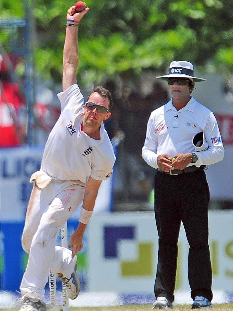 Graeme Swann delivers a ball during the third day