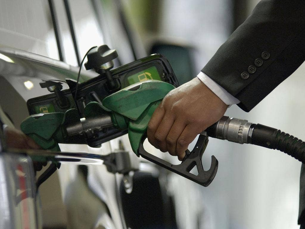 Drivers have been queueing for hundreds of yards to fill up at petrol pumps, following the Government's exhortation that drivers keep tanks topped up ahead of possible industrial action